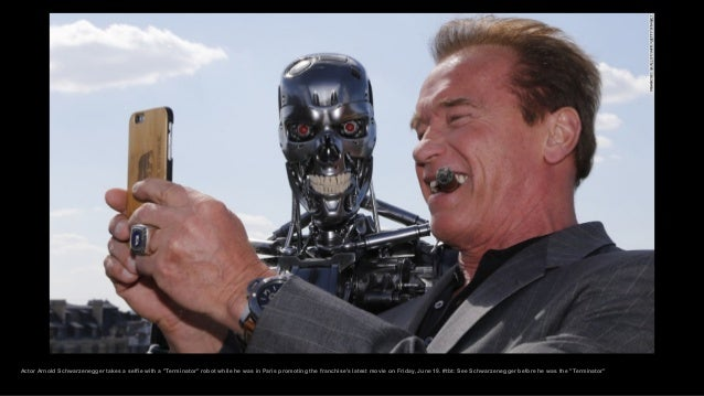 """Actor Arnold Schwarzenegger takes a selfie with a """"Terminator"""" robot while he was in Paris promoting the franchise's lates..."""