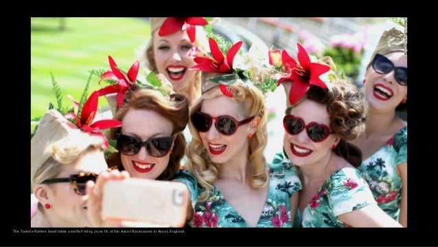 The Tootsie Rollers band takes a selfie Friday, June 19, at the Ascot Racecourse in Ascot, England.