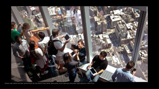 Visitors take selfies and other pictures from the One World Trade Center observatory, which opened to the public Friday, M...