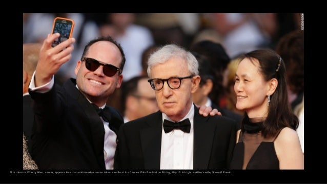Film director Woody Allen, center, appears less than enthused as a man takes a selfie at the Cannes Film Festival on Frida...