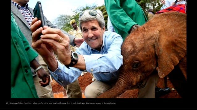 U.S. Secretary of State John Kerry takes a selfie with a baby elephant Sunday, May 3, while touring an elephant orphanage ...