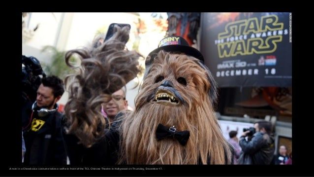 A man in a Chewbacca costume takes a selfie in front of the TCL Chinese Theatre in Hollywood on Thursday, December 17.