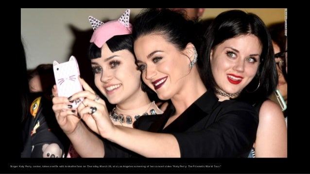 Singer Katy Perry, center, takes a selfie with lookalike fans on Thursday, March 26, at a Los Angeles screening of her con...