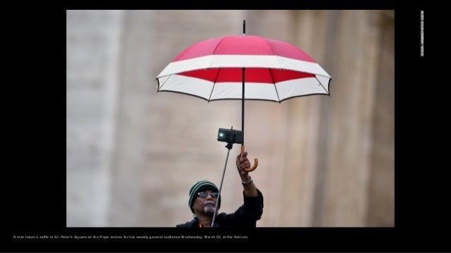 A man takes a selfie in St. Peter's Square as the Pope arrives for his weekly general audience Wednesday, March 25, at the...