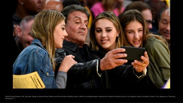 Sistine Rose Stallone, left, Sylvester Stallone, Sophia Rose Stallone and Scarlet Rose Stallone take a selfie at a basketb...