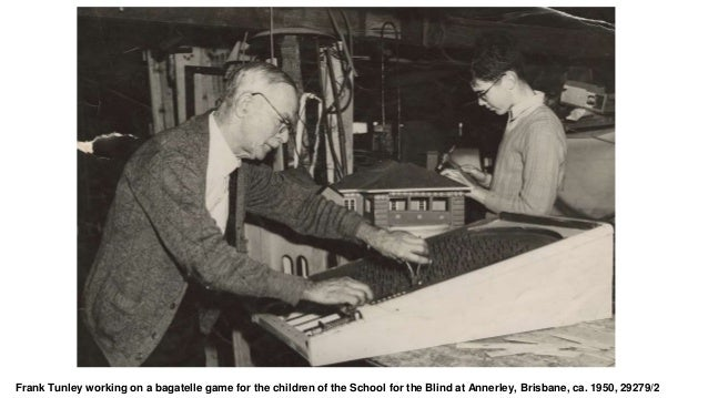 Frank Tunley working on a bagatelle game for the children of the School for the Blind at Annerley, Brisbane, ca. 1950, 292...