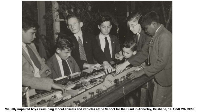 Visually impaired boys examining model animals and vehicles at the School for the Blind in Annerley, Brisbane, ca. 1950, 2...