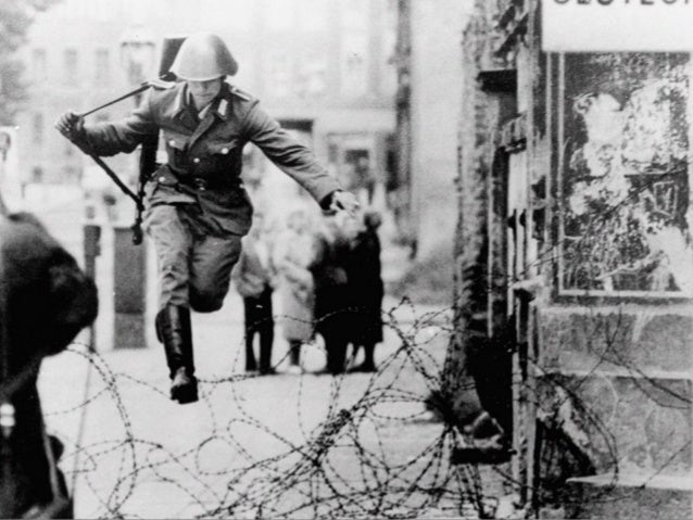 13 August 1961 The border between East and West Berlin is closed. Soldiers start to build the wall, at first with barbed w...