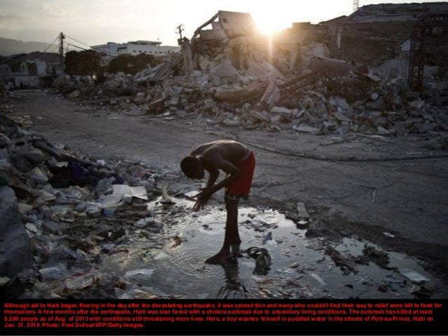 Haitians fight over items looted from collapsed buildings and stores. (January 20, 2010) WIN MCNAMEE—GETTY
