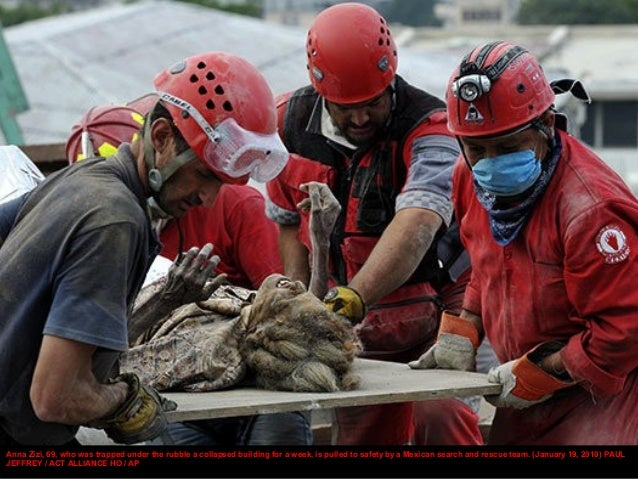 Members of the Los Angeles County Fire Department Search and Rescue Team rescue a Haitian woman who had been trapped in a ...