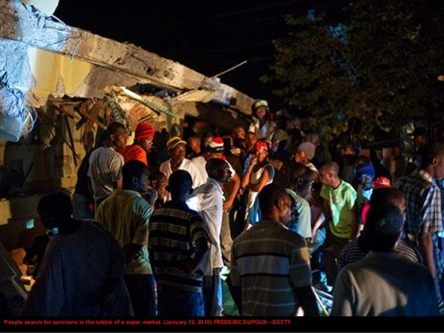 People gather in the street after the earthquake. (January 13, 2010) CRIS BIERRENBACH—AP