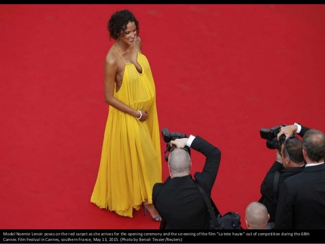 """Model Noemie Lenoir poses on the red carpet as she arrives for the opening ceremony and the screening of the film """"La tete..."""