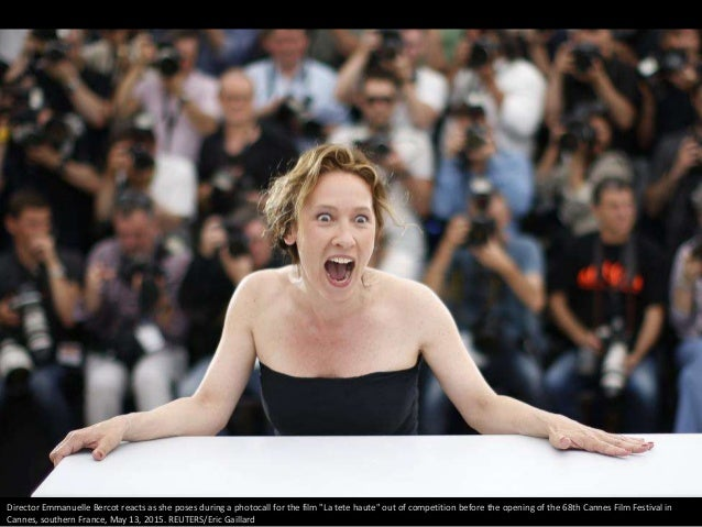 """Director Emmanuelle Bercot reacts as she poses during a photocall for the film """"La tete haute"""" out of competition before t..."""