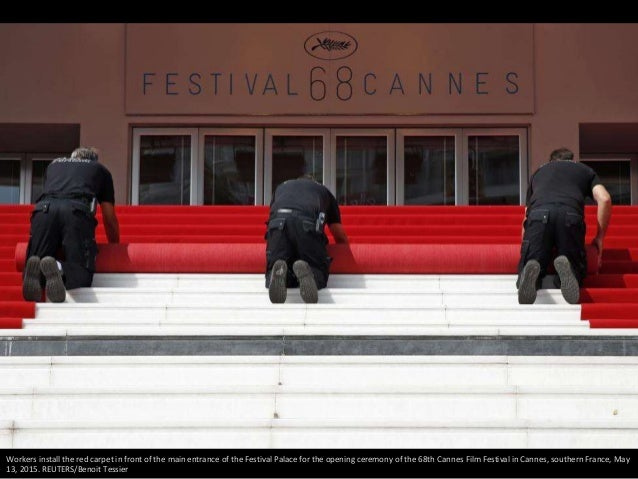 Workers install the red carpet in front of the main entrance of the Festival Palace for the opening ceremony of the 68th C...