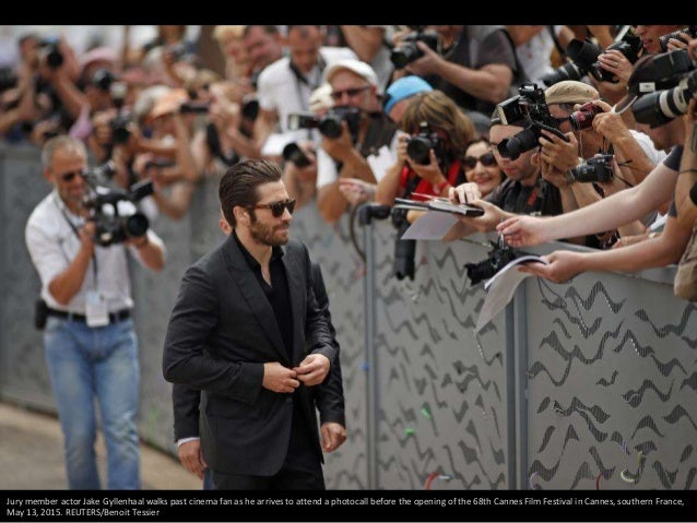 Jury member actor Jake Gyllenhaal walks past cinema fan as he arrives to attend a photocall before the opening of the 68th...