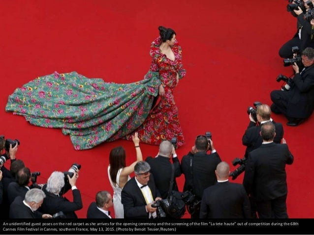 """An unidentified guest poses on the red carpet as she arrives for the opening ceremony and the screening of the film """"La te..."""