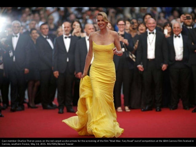 """Cast member Charlize Theron poses on the red carpet as she arrives for the screening of the film """"Mad Max: Fury Road"""" out ..."""