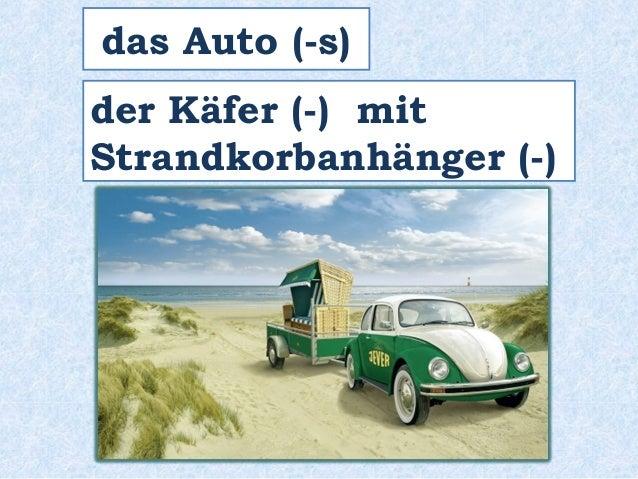 das Auto (-s)  der Käfer (-) mit  Strandkorbanhänger (-)