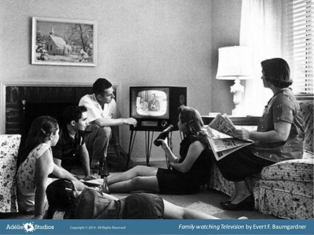 Family watching Television by EvertF. Baumgardner