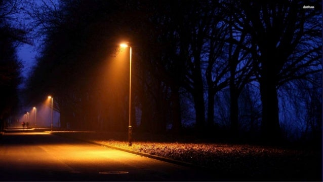Imagine you're walking down the street at night. It's dark, except for the occasional street lamp. You notice a figure cra...