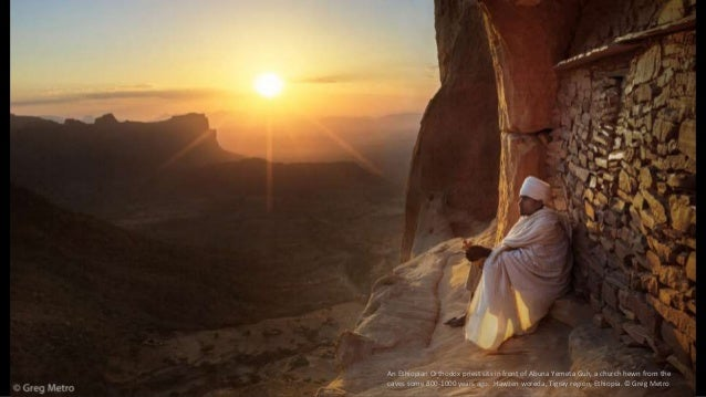 An Ethiopian Orthodox priest sits in front of Abuna Yemeta Guh, a church hewn from the caves some 800-1000 years ago. Hawz...