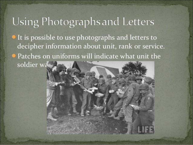 """Photographs of vehicles can provide information. In this photograph """"36- 141-1"""" on the left bumper and """"1HQ-6 """" on the ri..."""