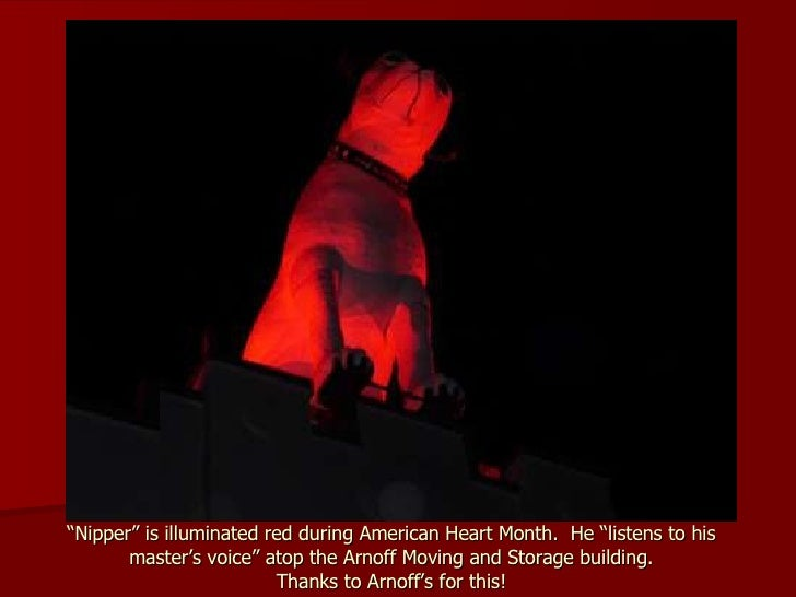 """"""" Nipper"""" is illuminated red during American Heart Month.  He """"listens to his master's voice"""" atop the Arnoff Moving and S..."""