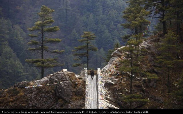 Porter Lakpa Sherpa, 42, walks along the tracks while on his way to Everest base camp in Solukhumbu District April 26, 201...
