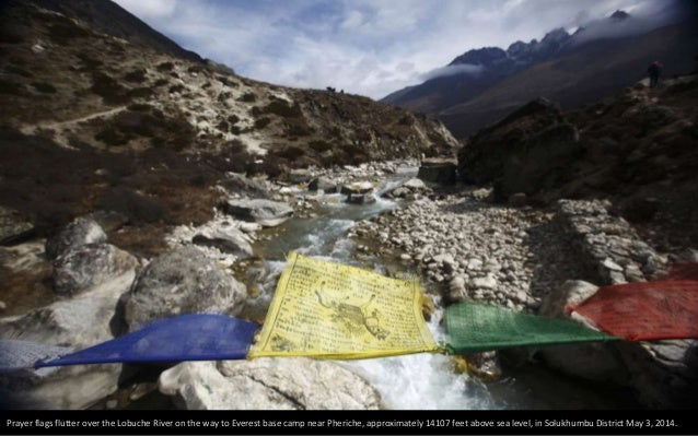 A porter carries mattresses back from Everest base camp, approximately 17388 feet above sea level, in Solukhumbu District ...