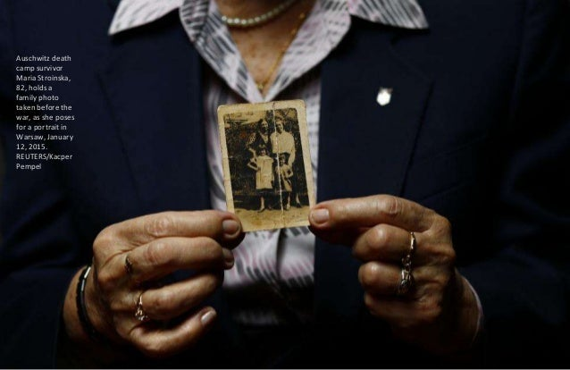 Auschwitz death camp survivor Lajos Erdelyi, 87, holds a drawing made by a campmate as he poses for a portrait in Budapest...