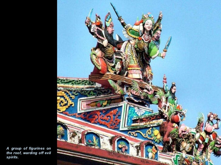 A group of figurines on the roof, warding off evil spirits.