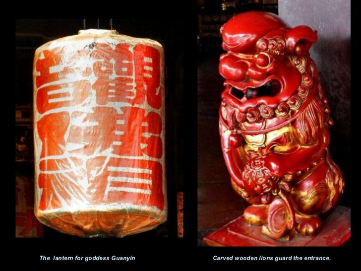 The  lantern for goddess Guanyin Carved wooden lions guard the entrance.