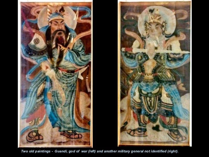 Two old paintings -  Guandi, god of  war (left) and another military general not identified (right).