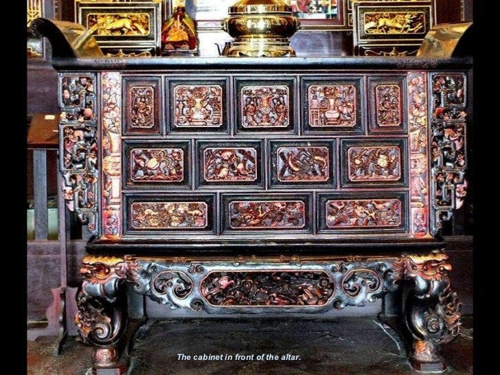 The cabinet in front of the altar.