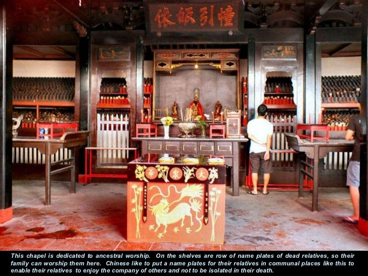 This chapel is dedicated to ancestral worship.  On the shelves are row of name plates of dead relatives, so their family c...