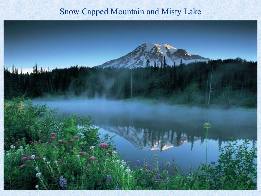 Snow capped mountain and misty Pretty places around the world