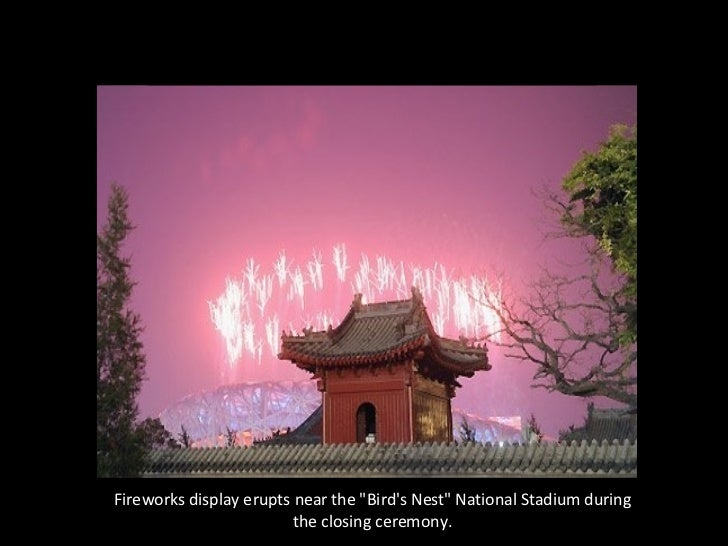 """Fireworks display erupts near the """"Bird's Nest"""" National Stadium during the closing ceremony."""