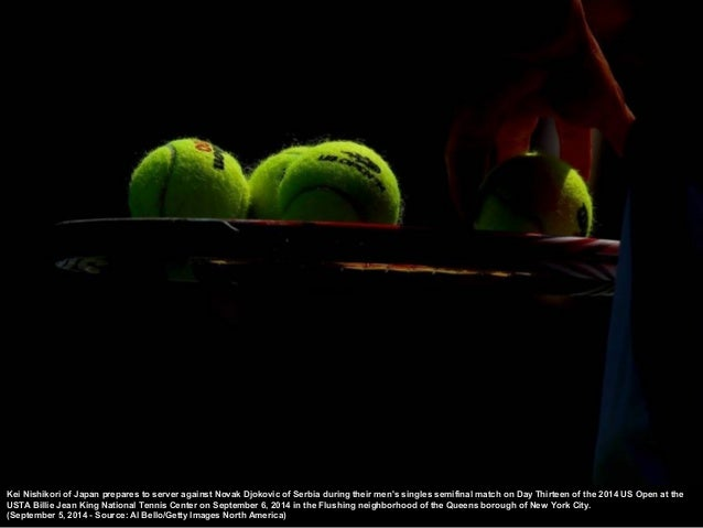 Novak Dj okovic of Serbia serves against Kei Nishikori of J apan during their men's singles semifinal match on Day Thirtee...