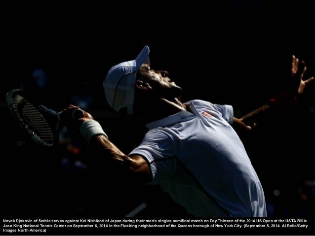 Kei Nish ikori of Japan serves against Novak Djokovic of S erbia during their men's singles semifinal match on Day Thirtee...