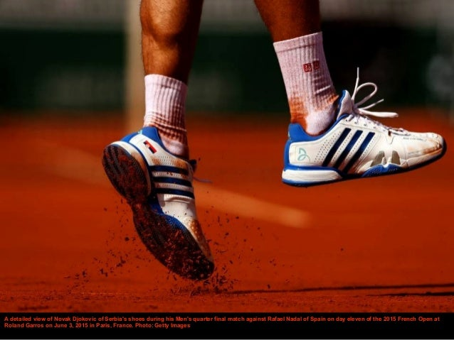 A detailed view of Novak Djokovic of Serbia's shoes during his Men's quarter final match against Rafael Nadal of Spain on ...