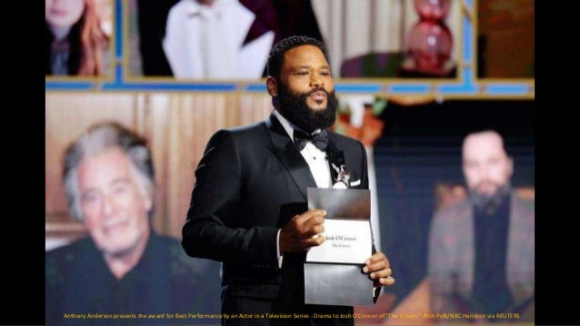 """Anthony Anderson presents the Best Television Actor - Drama Series award for """"The Crown """" to Josh O'Connor. Christopher Po..."""