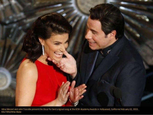 Idina Menzel and John Travolta present the Oscar for best original song at the 87th Academy Awards in Hollywood, Californi...