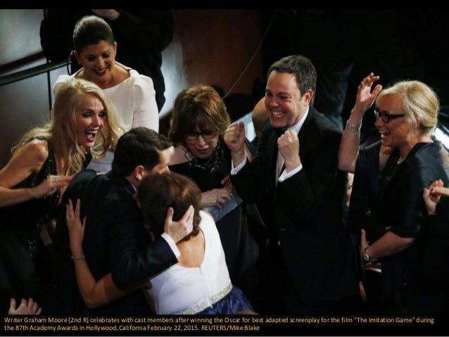 Writer Graham Moore (2nd R) celebrates with cast members after winning the Oscar for best adapted screenplay for the film ...