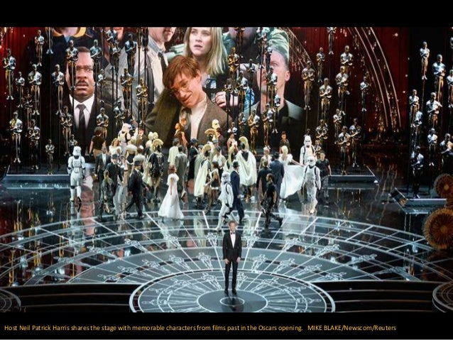Host Neil Patrick Harris shares the stage with memorable characters from films past in the Oscars opening. MIKE BLAKE/News...