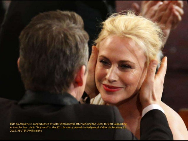 Patricia Arquette is congratulated by actor Ethan Hawke after winning the Oscar for Best Supporting Actress for her role i...
