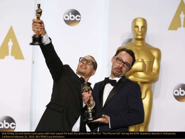 """Mat Kirkby (L) and James Lucas pose with their award for best live action short film for """"The Phone Call"""" during the 87th ..."""