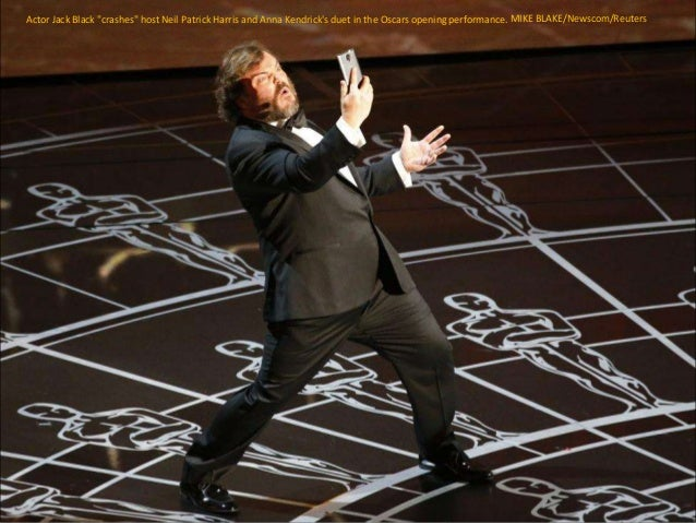 "Actor Jack Black ""crashes"" host Neil Patrick Harris and Anna Kendrick's duet in the Oscars opening performance. MIKE BLAKE..."