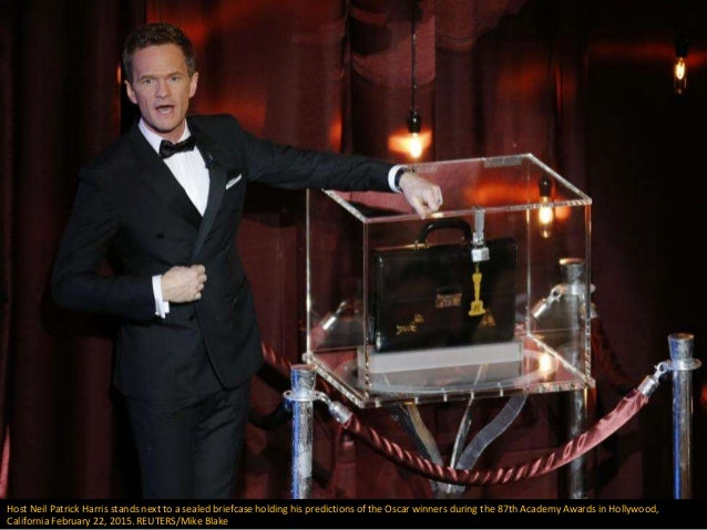 Host Neil Patrick Harris stands next to a sealed briefcase holding his predictions of the Oscar winners during the 87th Ac...