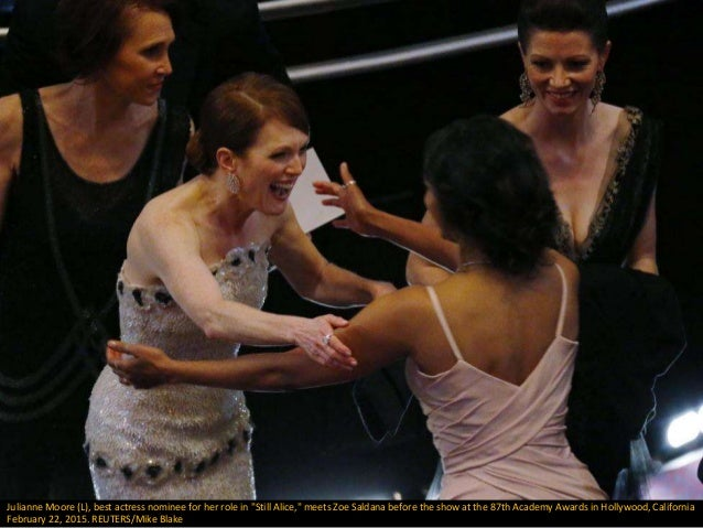 "Julianne Moore (L), best actress nominee for her role in ""Still Alice,"" meets Zoe Saldana before the show at the 87th Acad..."