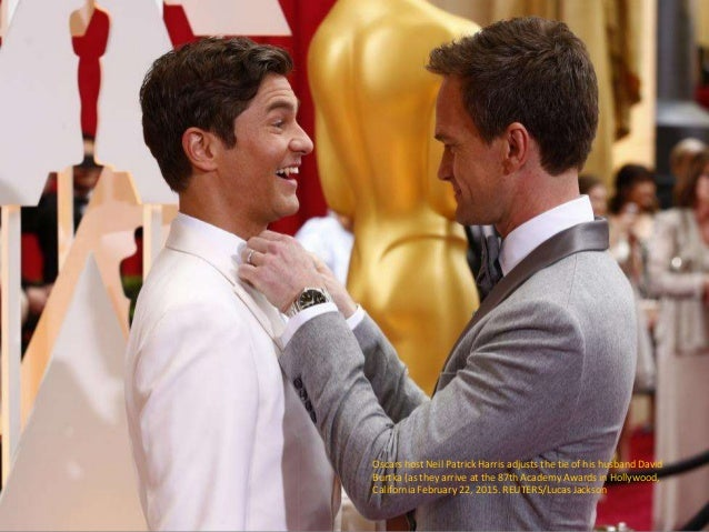 Oscars host Neil Patrick Harris adjusts the tie of his husband David Burtka (as they arrive at the 87th Academy Awards in ...